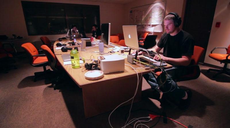 Carl editing at the station.